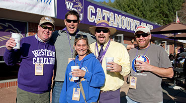 Catamount Club Members on the Paws Porch at a football game